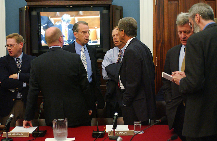 9/22/04.TAX CONFERENCE--Senate Finance Chairman Charles E. Grassley, R-Iowa, middle, Sen. Don Nickles, R-Okla., Sen. Trent Lott, R-Miss., and Senate Finance ranking Democrat Max Baucus, D-Mont., right, as they wait for the joint House-Senate tax conference to begin; it ended up being postponed..CONGRESSIONAL QUARTERLY PHOTO BY SCOTT J. FERRELL