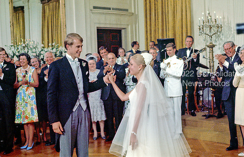 Washington, DC - June 12, 1971 -- Tricia Nixon Cox, right, prepares to dance with husband Edward, left, as guests and family applaud at the reception in the East Room of the White House in Washington, D.C. following the wedding ceremony in the Rose Garden on Saturday, June 12, 1971.  .Credit: Pool via CNP