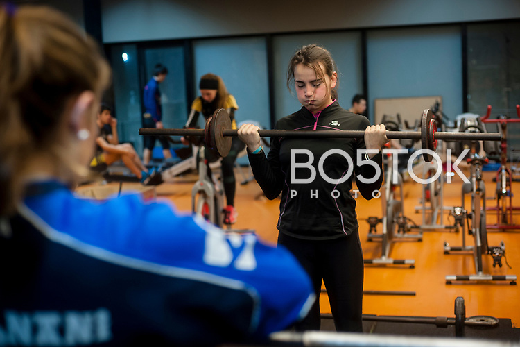 Some female rowers on San Juan rower Club on a workout session in the club's gym. Pasaia (Basque Country). January 26, 2017. (Gari Garaialde / BostokPhoto)