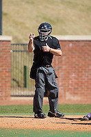 Home plate umpire Josh Reep makes a strike call during the NCAA baseball game between the LIU-Brooklyn Blackbirds and the High Point Panthers at Willard Stadium on March 8, 2015 in High Point, North Carolina.  The Panthers defeated the Blackbirds 9-0.  (Brian Westerholt/Four Seam Images)