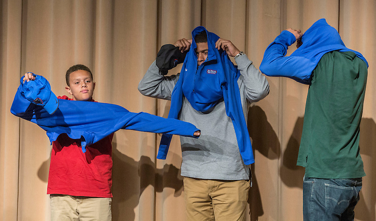 Dave Leitao's three sons don their Blue Demon gear during a press conference Monday, March 30, 2015, where Leitao was named the school's new head coach of the men's basketball program. (DePaul University/Jamie Moncrief)
