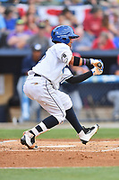 Asheville Tourists center fielder Manny Melendez (19) squares to bunt during a game against the Charleston RiverDogs at McCormick Field on July 4, 2017 in Asheville, North Carolina. The Tourists defeated the RiverDogs 2-1. (Tony Farlow/Four Seam Images)
