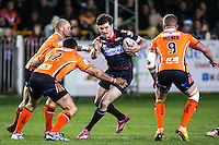 Picture by Alex Whitehead/SWpix.com - 06/03/2015 - Rugby League - First Utility Super League - Castleford Tigers v Wigan Warriors - the Mend A Hose Jungle, Castleford, England - Wigan's John Bateman is tackled by Castleford's Matt Cook.