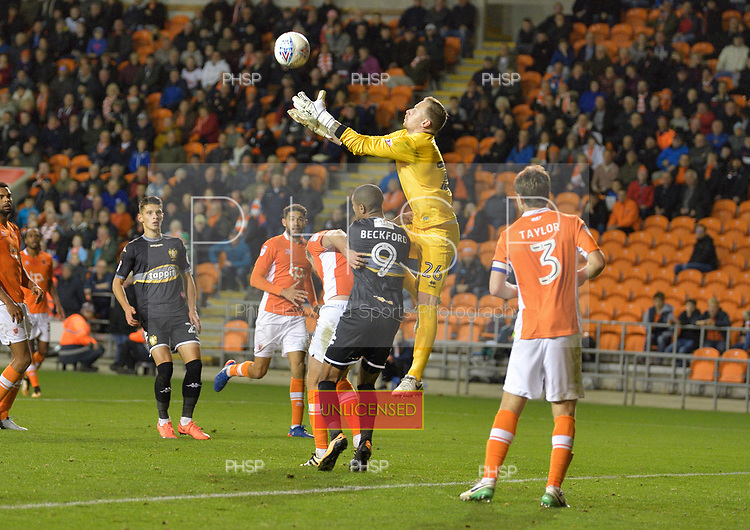 17/10/2017 Sky Bet League 1 Blackpool v Bury<br /> <br /> Ryan Allsop collects under pressure from Jermaine Beckford
