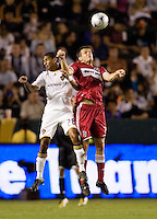 Chicago Fire forward Brian McBride (20) and LA Galaxy defender Troy Roberts (12) go high for a ball during a MLS match. The Chicago Fire defeated the LA Galaxy 1-0 at Home Depot Center stadium in Carson, California on Thursday, August 21, 2008.