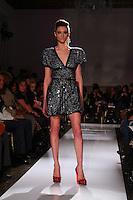 A model walks the runway during the fall 2009 Arutyunov Sa catwalk show during London Fashion Week, Friday, Feb. 20, 2009 in London. (Tina Gao/pressphotointl.com)