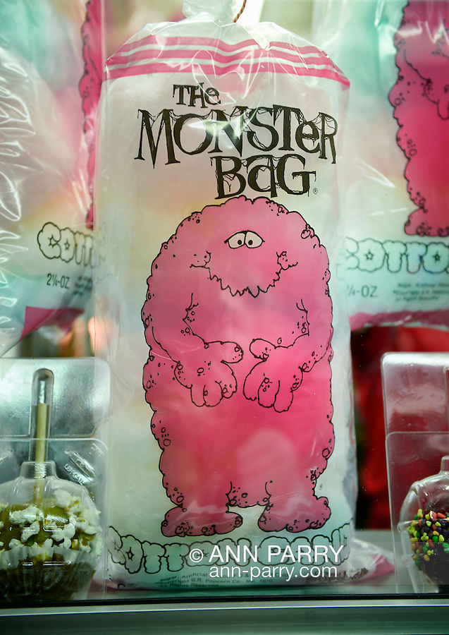Pink Monster Bags of Cotton Candy are in the window of a food booth, on the first day of the annual Herricks Community Fund Spring Carnival, which raises funds for programs that enrich the community and school district. The Long Island carnival runs through June 2.