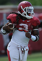 NWA Democrat-Gazette/ANDY SHUPE<br /> Arkansas running back Alex Collins carries the ball Tuesday, Aug. 11, 2015, during practice at the university's practice field in Fayetteville.