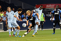 Graham Susi (blue) Sporting KC midfielder Steven Lenhart (24) San Jose Earthquakes forward, Birahim Diop (Sporting KC) midfielder.. Sporting KC defeated San Jose Earthquakes 1-0 at LIVESTRONG Sporting Park, Kansas City, Kansas.