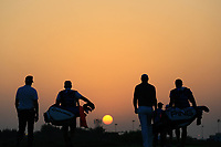 Players and caddies leave the 18th tee at sunset during the second round of the NBO Open played at Al Mouj Golf, Muscat, Sultanate of Oman. <br /> 16/02/2018.<br /> Picture: Golffile | Phil Inglis<br /> <br /> <br /> All photo usage must carry mandatory copyright credit (&copy; Golffile | Phil Inglis)
