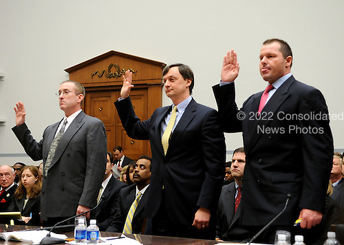 "Washington, DC - February 13, 2008 -- Roger Clemens, former New York Yankee pitcher, right, Charlie Scheeler, Investigator on Senator Mitchell's staff, center; and Brian McNamee, former Major League Baseball strength and conditioning coach, left; testify before the United States House of Representatives Committee on Government Operations and Reform hearing on ""The Mitchell Report: The Illegal use of Steroids in Major League Baseball, Day 2""  concerning alleged use of steroids and human growth hormone (HGH) by Clemens and several other major league players in Washington, D.C. on Wednesday, February 13, 2008.  .Credit: Ron Sachs / CNP.(RESTRICTION: NO New York or New Jersey Newspapers or newspapers within a 75 mile radius of New York City)"