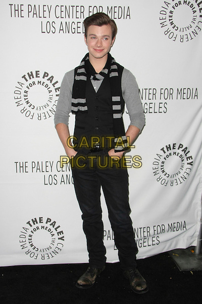 "CHRIS COLFER.The PaleyFest 2011 Panel for ""Glee"" held at The Saban Theater in Beverly Hills, California, USA..March 16th, 2011.full length waistcoat grey gray black scarf jeans denim hands in pockets  .CAP/ADM/TB.©Tommaso Boddi/AdMedia/Capital Pictures."