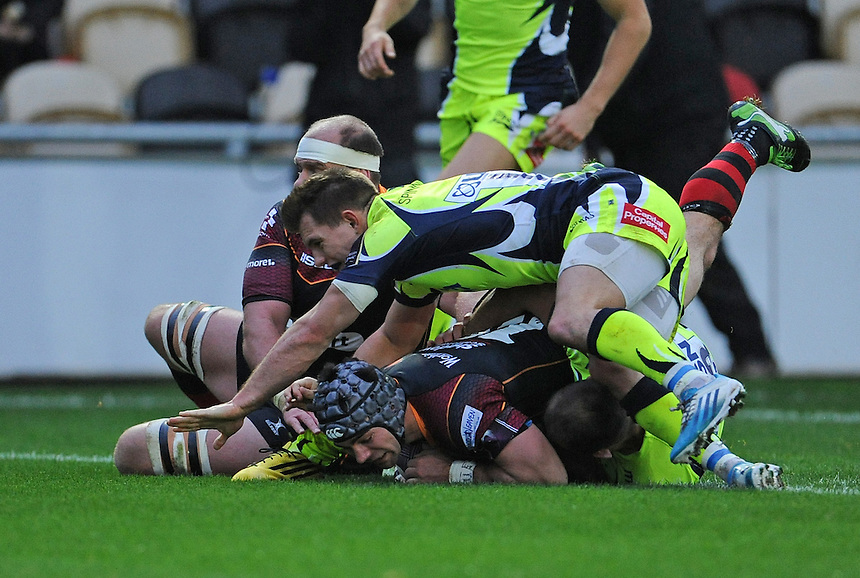 Newport Gwent Dragons' Adam Hughes scores his sides third try<br /> <br /> Photographer Ian Cook/CameraSport<br /> <br /> Rugby Union - European Rugby Challenge Cup Pool 2 - Newport Gwent Dragons v Sale Sharks - Sunday 15th November 2015 - Rodney Parade - Newport<br /> <br /> &copy; CameraSport - 43 Linden Ave. Countesthorpe. Leicester. England. LE8 5PG - Tel: +44 (0) 116 277 4147 - admin@camerasport.com - www.camerasport.com