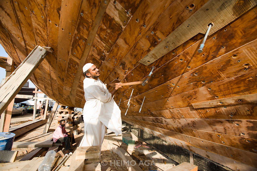 Dubai Creek. The Dhow-Building Yard. Driving in giant nails.