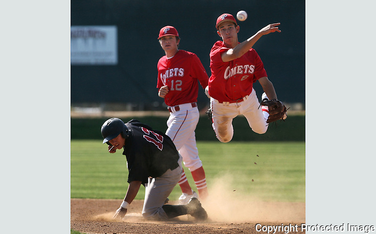 Palomar's Matt Gabrielson makes the throw to first but couldn't turn the double play<br />
