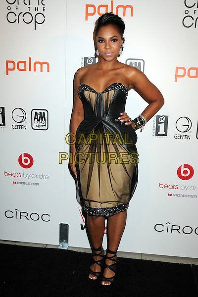 "ASHANTI (Ashanti Shequoiya Douglas).Interscope Geffen A&M Records 4th Annual ""Creme of the Crop"" Post BET Awards 2010 Celebration held at Mr. Chow Restaurant,  Beverly Hills, California, USA, 27th June 2010..full length hand on hip black beige gold layered tulle dress strappy shoes sandals  strapless .CAP/ADM/BP.©Byron Purvis/AdMedia/Capital Pictures."