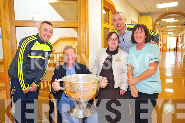 Michael Greaney, Margaret Naughton and Sheila Hughes meet Kerry footballers Kieran Donaghy and Barry John Keane with the Sam Maguire cup at  Bon Secours on Monday