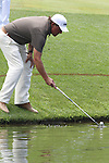 US Open 2011 Bethesda, MD. 17/6/11.Phil Mickelson (USA) fishing his ball from the water.on day two of the USGA US OPEN at Congressional country club, Bethesda, Washington..Picture Fran Caffrey/www.golffile.ie