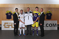 Pictured L-R: Albert Sin, Goldenway Precious Metal operation manager, Leon Britton, chairman Huw Jenkins, Ben Davies and Darren Vickers, Goldenway UK director at the official launch of the 2013-2014 Swansea City Football Club kit launch at the Liberty Stadium, Swansea, south Wales. Friday 28th of June 2013