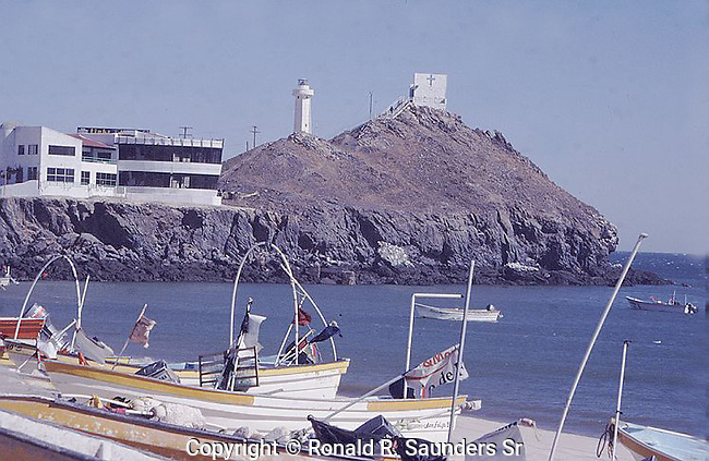 PANGA BOATS on the BEACH,  MOUNTAIN,LIGHTHOUSE and RESTAURANT