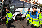 "© Joel Goodman - 07973 332324 . 09/12/2010 . London , UK . A man carrying a home made placard with the words "" Blue plague "" works parallel to a unit of evidence gatherer police . Students and their supporters demonstrate in Parliament Square in London against government cuts to student support , Educational Maintenance Allowance ( EMA ) and rising university tuition fees . Photo credit : Joel Goodman"