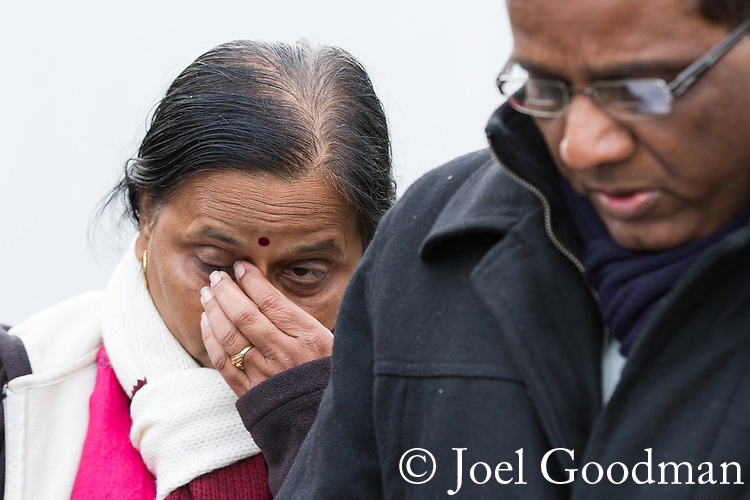 © Joel Goodman - 07973 332324 . 02/01/2012 . Salford , UK . Anuj's mother and father Yogini and Subhash . The parents of Anuj Bidve visit the scene of Anuj Bidve's murder, on Ordsall Lane , where a memorial shrine of flowers, candles and messages has been built . Bidve was shot and killed by Kiaran Stapleton on 26 December 2011 . Photo credit: Joel Goodman