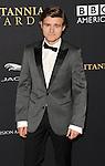 Callan McAuliffe attending the 2014 BAFTA Los Angeles Jaguar Britannia Awards Presented BY BBC America, held at The Beverly Hilton Hotel Beverly Hills, CA. October 30, 2014.