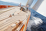Onboard Shamrock V (JK3) during the Regates Royales in Cannes, France. Shamrock V was built in 1930 for Sir Thomas Lipton's fifth and last America's Cup challenge. Designed by Nicholson, she was the first British yacht to be built to the new J Class Rule and is the only remaining J to have been built in wood.