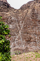 "Pele's signature letter ""X"" carved onto the side of a cliff in Nualolo Kai village, Na Pali Coast, Kaua'i"
