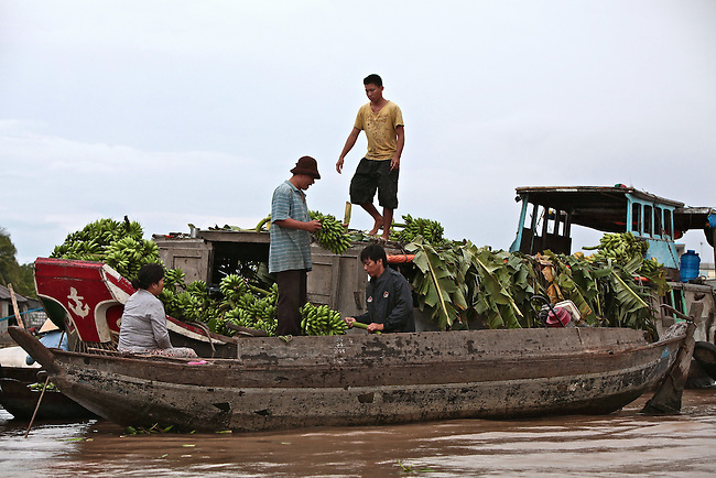 A banana wholesaler does business at the Cai Rang floating market, on the Hau River in the Mekong Delta, south of Can Tho, Vietnam. Merchants typically deal in only one item. Sept. 30, 2011.