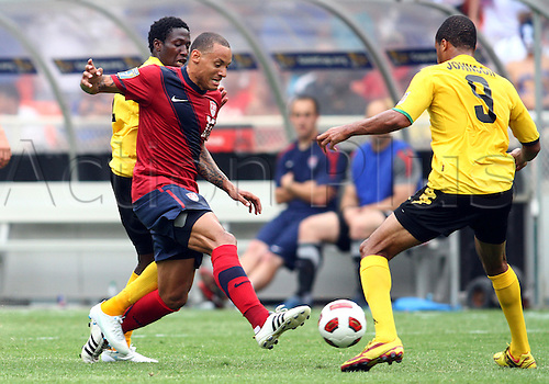 19.06.2011. Washington, USA.  Jermaine Jones (13) of  USA is challenged by Ryan Johnson (9) of Jamaica during a CONCACAF Gold Cup quarter-final match at RFK stadium in Washington D.C. USA won 2-0.