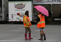 May 3, 2013; Commerce, GA, USA: NHRA event security workers in the pit area during a rain delay to qualifying for the Southern Nationals at Atlanta Dragway. Mandatory Credit: Mark J. Rebilas-