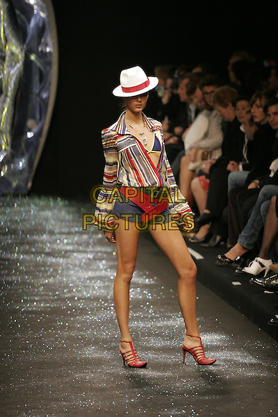 MODEL.Largerfeld Spring/Summer 2005 ready-to-wear collection, Paris, France, October 6th 2004..half length catwalk Karl fashion show striped shirt red belt hat.Ref: MDS.www.capitalpictures.com.sales@capitalpictures.com.©O.Medias/Capital Pictures .