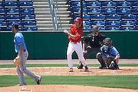 Clearwater Threshers third baseman Mitch Walding (10) hits a pitch from Hunter Wood (3) while at bat in front of catcher Mac James (8) and umpire Mike Savakinas during a game against the Charlotte Stone Crabs on April 13, 2016 at Bright House Field in Clearwater, Florida.  Charlotte defeated Clearwater 1-0.  (Mike Janes/Four Seam Images)