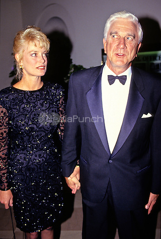 Actor Leslie Nielson, left, and Barbaree Earl, left, arrive for the State Dinner hosted by United States President George H.W. Bush and first lady Barbara Bush honoring President V&middot;clav Havel of Czechoslovakia at the White House in Washington, DC on October 22, 1991.<br /> Credit: Ron Sachs / CNP/MediaPunch