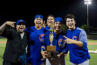 Kevin Zamudio (4), Carlos Sepulveda (16), and Faustino Carrera (97) of the AZL Cubs pose with the Chuck Jared Championship Cup after winning Game Three of the Arizona League Championship Series against the AZL Giants on September 7, 2017 at Scottsdale Stadium in Scottsdale, Arizona. AZL Cubs defeated the AZL Giants 13-3 to win the series two games to one. (Zachary Lucy/Four Seam Images)