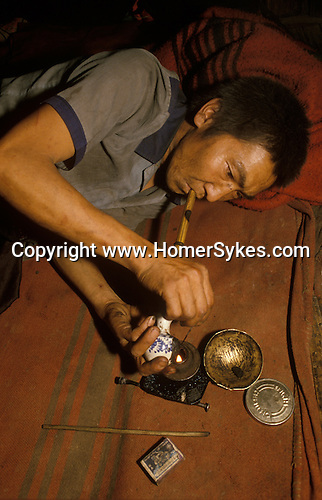 Chasing the dragon opium addict heroin Northern Thailand. South East Asia