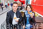 Marta and Dirius Caskowska, enjoying their hotdogs at the Food Fare in Tralee on Sunday