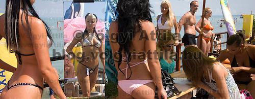 Competitors prepare for the Miss Bikini beauty contest held near lake Balaton.
