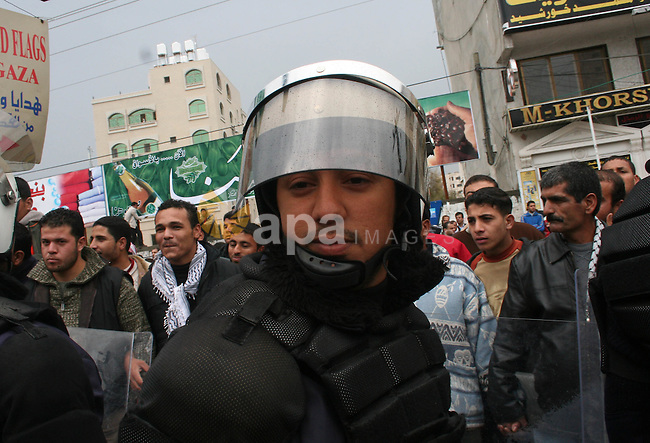 Palestinians attend a protest to demand jobs in the Palestinian Authority, in Gaza. Palestinian leaders struck discordant notes on how to deal with Israel on Saturday as parliament met to usher in a unity government intended to halt factional fighting and ease a crippling Western aid embargo.
