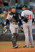 Catcher Tony Delmonico #7 of the Great Lakes Loons chats with JonMichael Redding #21 on the mound at Fifth Third Field April 21, 2009 in Dayton, Ohio. (Photo by Brian Westerholt / Four Seam Images)