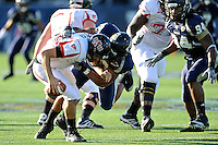 27 November 2010:  FIU defensive end Tourek Williams (97) sacks Arkansas State quarterback Ryan Aplin (16) in the first quarter as the FIU Golden Panthers defeated the Arkansas State Red Wolves, 31-24, at FIU Stadium in Miami, Florida.