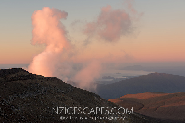 Steaming Ketetahi Hot Springs with Lake Rotoaira in distance in light of sunset, Tongariro National Park, UNESCO World Heritage Area, Central Plateau, North Island, New Zealand, NZ
