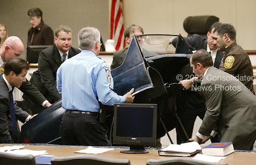 Law enforcement personal bring in a model of the trunk of the Chevrolet Caprice that sniper suspect John Allen Muhammad was captured in during court proceedings in Virginia Beach Circuit Court in Virginia Beach, Virginia, November 6, 2003. <br /> Credit: Tracy Woodward - Pool via CNP