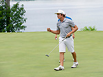 MUSCLE SHOALS, AL - MAY 25: Lynn's Carlos Bustos reacts to sinking the winning putt during the Division II Men's Team Match Play Golf Championship held at the Robert Trent Jones Golf Trail at the Shoals, Fighting Joe Course on May 25, 2018 in Muscle Shoals, Alabama. Lynn defeated West Florida 3-2 to win the national title. (Photo by Cliff Williams/NCAA Photos via Getty Images)