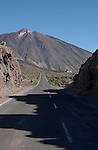 Shadows of rocks on the road to Mount Teide showing church on the right. Tenerife, Cañadas national park. Canary Islands.