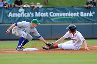 Third baseman Keaton Briscoe (11) of the Greenville Drive is tagged out at third by third baseman Hunter Dozier of the Lexington Legends on Monday, August 19, 2013, at Fluor Field at the West End in Greenville, South Carolina. Lexington won, 5-1. (Tom Priddy/Four Seam Images)