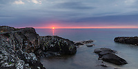 A beautiful morning sunrise along the rocky Lake Superior shoreline. Marquette, MI