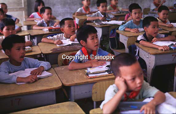 CLASSROOMS ARE PACKED FULL OF BOYS WITH A FEW GIRLS ONLY  IN A SMALL VILLAGE IN FOGUANG COUNTY GUANGDON, CHINA.  THE POLICY HAS RESULTED IN MANY MORE BOYS THAN GIRLS BEING BORN AND AN IMBALANCE IN THE POPULATION.
