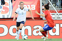 US Women's National midfielder Heather O'Reilly (9) and Korea Republic midfielder Lee Sejin (5) in action during the International Friendly soccer match between the USA Women's National team and the Korea Republic Women's Team held at Gillette Stadium in Foxborough Massachusetts.   Eric Canha/CSM